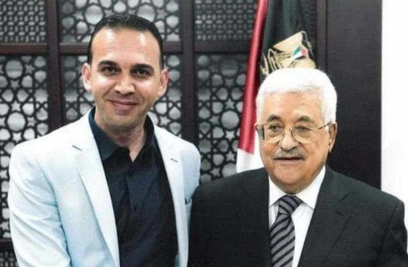 Palestinian journalist Hassan al-Najjar is seen shaking hands with PA President Mahmoud Abbas. (photo credit: Courtesy)