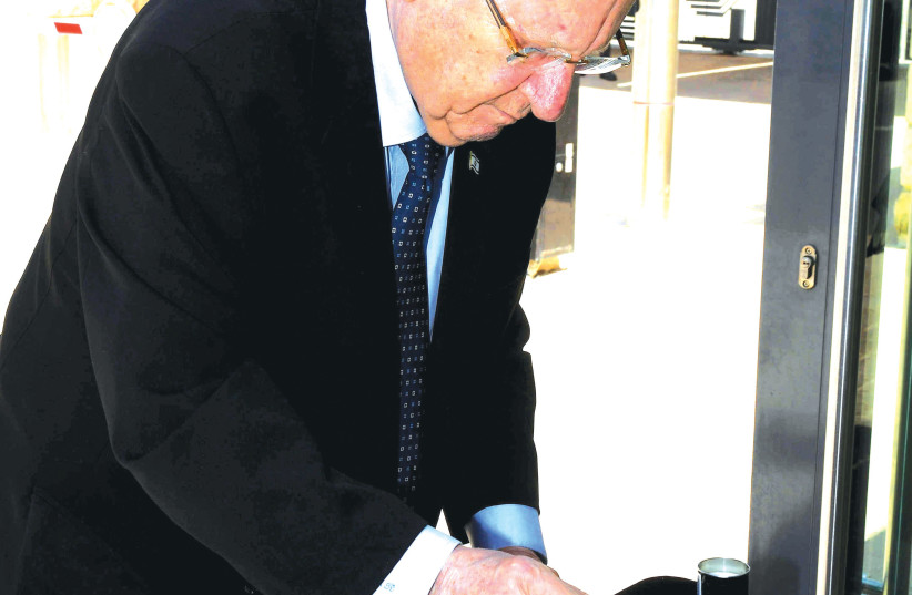 PRESIDENT REUVEN RIVLIN lights memorial candles for Mount Meron victims on Friday. (photo credit: MARK NEYMAN/GPO)