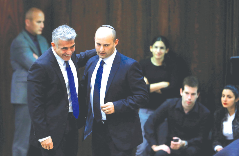 YAIR LAPID (left) walks with Naftali Bennett at the Knesset in Jerusalem in 2013. (photo credit: BAZ RATNER/REUTERS)