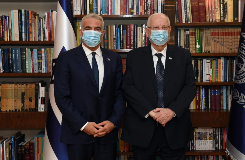 Yesh Atid leader Yair Lapid (L) pictured next to President Reuven Rivlin (photo credit: AVI KENNER/GPO)
