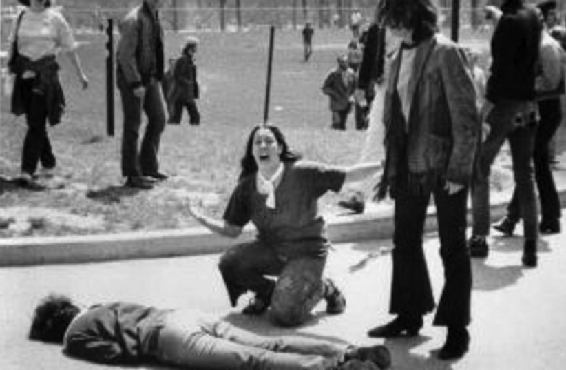 JOHN FILO'S Pulitzer Prize-winning photograph shows Mary Ann Vecchio kneeling over the body of Jeffrey Miller minutes after the unarmed student was shot dead by an Ohio National Guardsman. (photo credit: Wikimedia Commons)