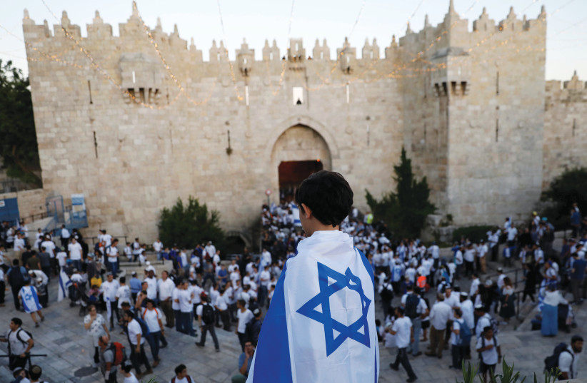 THE TOUCHING ceremony began in 1967 and marks the reunification of Jerusalem.  (photo credit: RONEN ZVULUN/REUTERS)