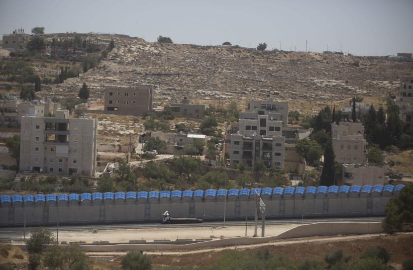 Houses at the Arab village of Beit Zafafa next to Givat Hamatos neighborhood of Jerusalem on July 05, 2016. (photo credit: LIOR MIZRAHI/FLASH90)