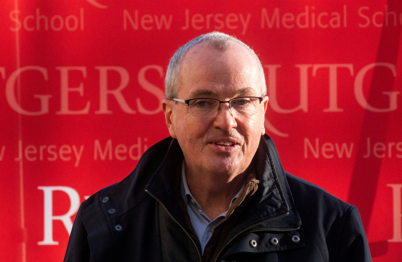 New Jersey Governor Phil Murphy speaks to the media after attending a tour at University Hospital's COVID-19 vaccine clinic at Rutgers New Jersey Medical School in Newark, New Jersey. (credit: EDUARDO MUNOZ / REUTERS)