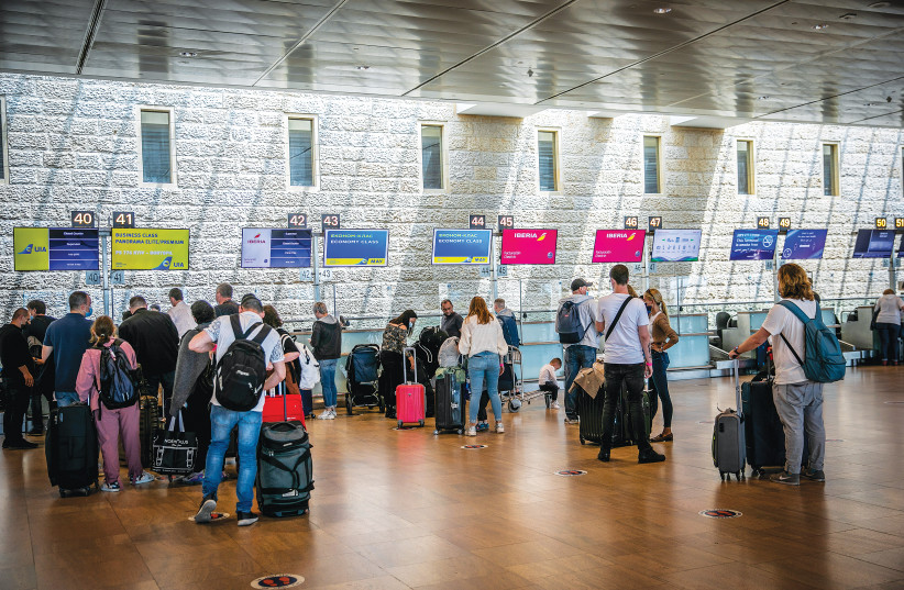 TRAVELERS CONVERGE at Ben-Gurion Airport late last month, as the skies begin to open up. (photo credit: YOSSI ALONI/FLASH90)