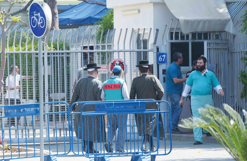 NEXT OF KIN of the victims of last week's tragedy at Mount Meron arrive at the Abu Kabir Forensic Institute in Tel Aviv to identify the bodies of their loved ones. (photo credit: AVSHALOM SHOSHANI)
