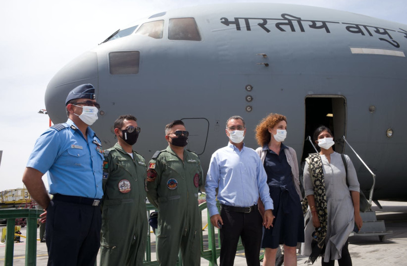 FROM LEFT to right: the air attaché at the Indian Embassy, the Indian Air Force flight team, Deputy Director General of Asia and the Pacific at the Ministry of Foreign Affairs, Gilad Cohen, Tami Ziv from the Economic Branch of the Foreign Ministry, and Indian Ambassador to Israel, Sanjeev Singla (photo credit: MINISTRY OF FOREIGN AFFAIRS)