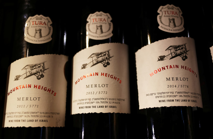"""Labels, including the words, """" Wine from the land of Israel"""", are seen on wine bottles at Tura Winery in Rehelim (photo credit: REUTERS/Ronen Zvulun)"""