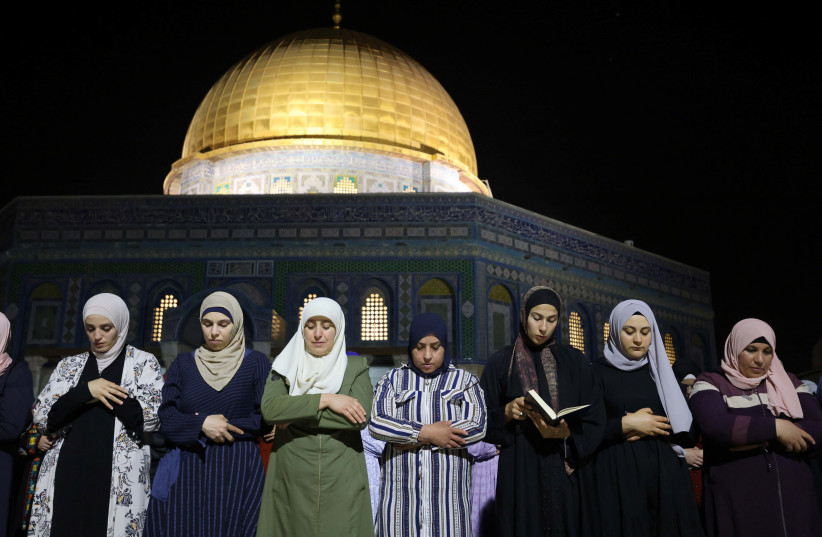 Palestinians pray on Laylat al-Qadr during the holy month of Ramadan, at the compound that houses Al-Aqsa Mosque, known to Muslims as Noble Sanctuary and to Jews as Temple Mount, in Jerusalem's Old City, May 8, 2021 (photo credit: REUTERS/AMMAR AWAD)