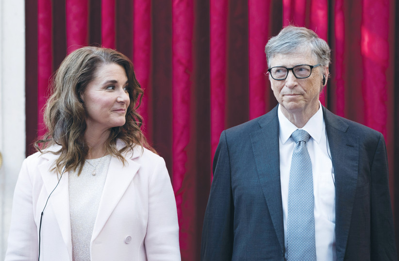 PHILANTHROPIST AND co-founder of Microsoft Bill Gates and his wife, Melinda, at the Elysee Palace in Paris, in 2017. (photo credit: KAMIL ZIHNIOGLU/REUTERS)