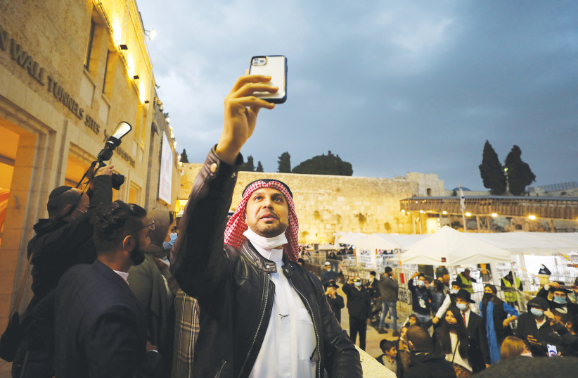 A MEMBER of a delegation from the United Arab Emirates takes a selfie at the Western Wall last year. (photo credit: AMMAR AWAD/REUTERS)
