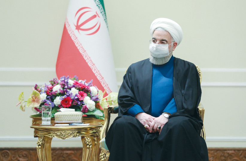 IRANIAN PRESIDENT Hassan Rouhani waits to meet with Russia's Foreign Minister Sergei Lavrov, in Tehran last month. (photo credit: IRANIAN PRESIDENCY OFFICE/WANA (WEST ASIA NEWS AGENCY)/HANDOUT VIA REUTERS)