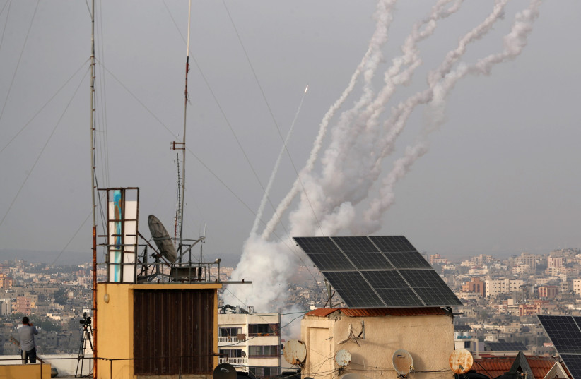 Rockets are launched into Israel from Gaza, May 10, 2021 (photo credit: MOHAMMED SALEM/REUTERS)