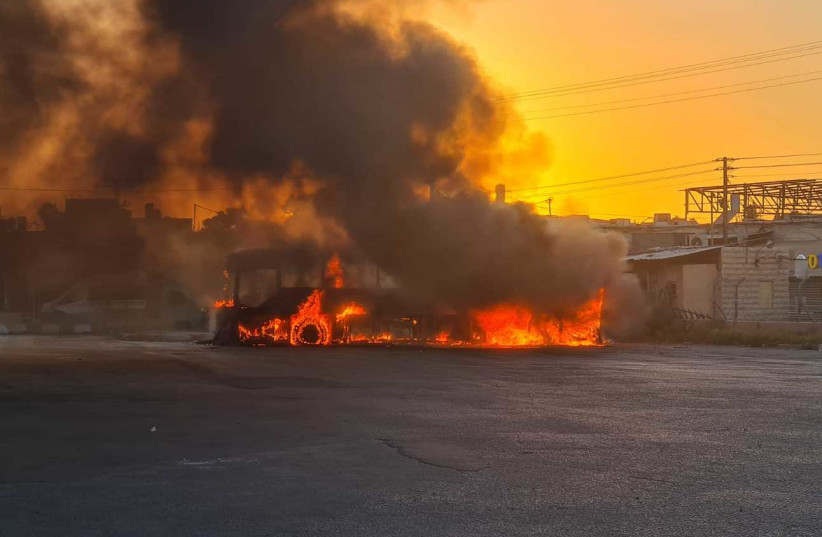 A burnt out bus after a day of riots in Lod, Israel, May 11, 2021 (photo credit: Courtesy)