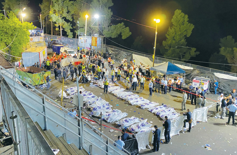 The bodies of the victims of the tragedy at Mount Meron on Lag Ba'omer. (credit: SHAY YERUSHALMI/BEHADREI HAREDIM/REUTERS)