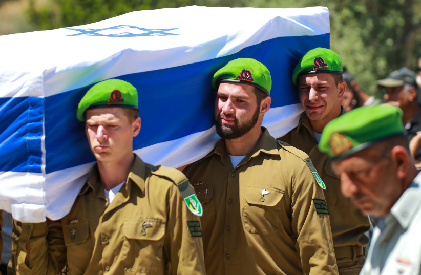 IDF soldiers are seen carrying the coffin of St.-Sgt. Omer Tabib, who was killed in strikes from Gaza. (photo credit: OMRI STEIN/FLASH90)