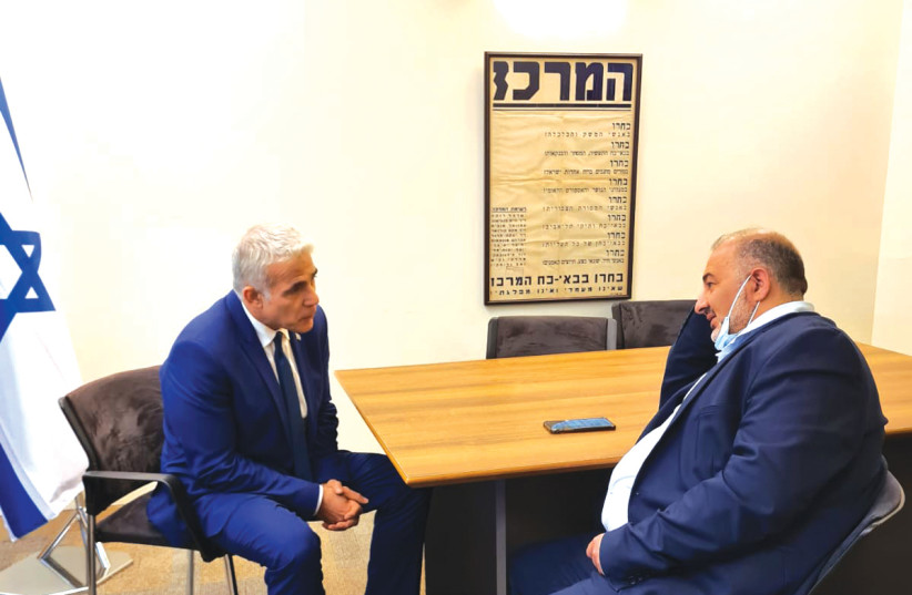 YESH ATID leader Yair Lapid meets with the head of Ra'am, Mansour Abbas. (photo credit: COURTESY LAPID'S OFFICE)