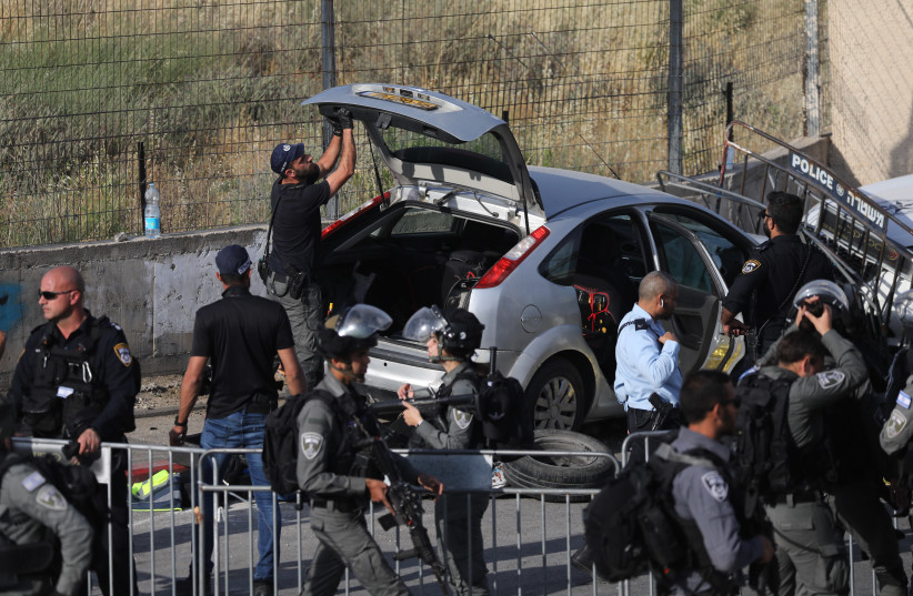 Police at the scene of a car ramming attack in east Jerusalem, with several injuries. The terror attack occurred in the Sheikh Jarrah neighborhood of east Jerusalem, on May 16, 2021. (photo credit: YONATAN SINDEL/FLASH 90)