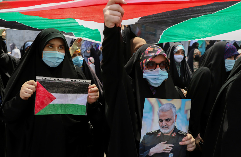 Iranian women gather during a protest to express solidarity with the Palestinian people amid a flare-up of Israeli-Palestinian violence, in Tehran, Iran May 18, 2021. (photo credit: MAJID ASGARIPOUR/WANA (WEST ASIA NEWS AGENCY) VIA REUTERS)