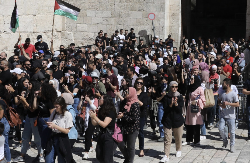 """Crowds gather at Damascus Gate in Jerusalem's Old City in response to Fatah's call for a Palestinian """"Day of Rage,"""" May 18th, 2021. (photo credit: MARC ISRAEL SELLEM/THE JERUSALEM POST)"""
