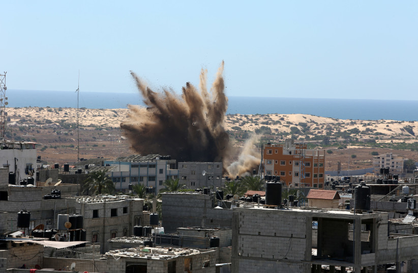 Flames and smoke billowing after an Israeli air strike on the city of Rafah, in the southern Gaza Strip, on May 19, 2021 (photo credit: ABED RAHIM KHATIB/FLASH90)
