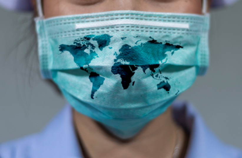 A woman wears a protective mask during the coronavirus pandemic (credit: TEL AVIV UNIVERSITY)