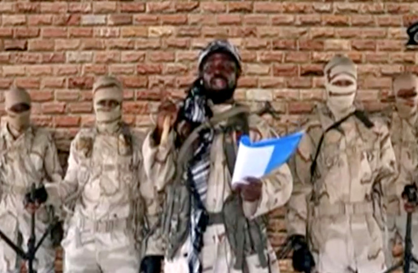 Boko Haram leader Abubakar Shekau speaks in front of guards in an unknown location in Nigeria in this still image taken from an undated video obtained on January 15, 2018. (credit: BOKO HARAM HANDOUT/SAHARA REPORTERS VIA REUTERS)