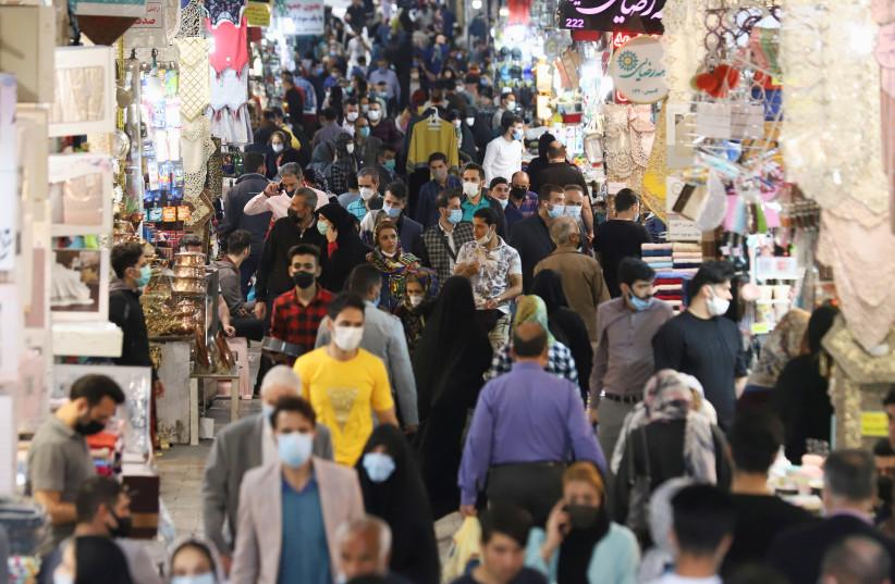 Iranian people walk in Tehran Bazaar, in Tehran (photo credit: MAJID ASGARIPOUR/WANA (WEST ASIA NEWS AGENCY) VIA REUTERS)