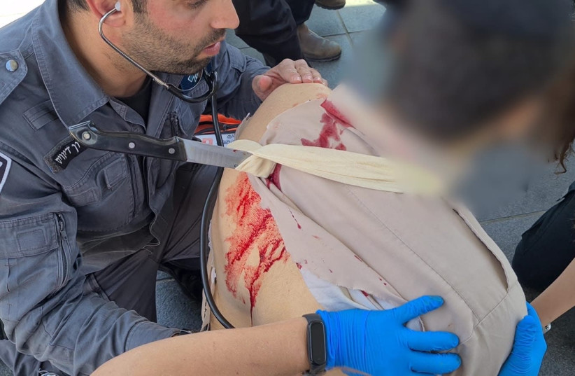 A soldier receives treatment after being stabbed in Jerusalem. (photo credit: POLICE SPOKESPERSON'S UNIT)