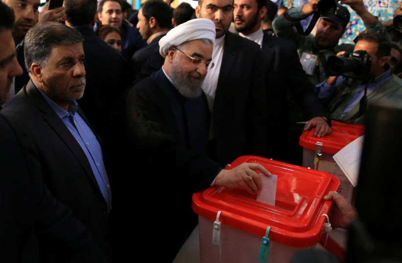 Iranian President Hassan Rouhani casts his vote during the presidential election in Tehran (photo credit: TIMA VIA REUTERS)