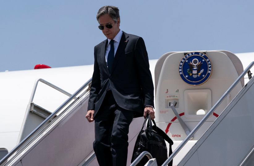 US Secretary of State Antony Blinken waves as he steps off his plane upon arrival at Cairo International Airport, in Cairo, Egypt May 26, 2021. (photo credit: ALEX BRANDON/POOL VIA REUTERS)