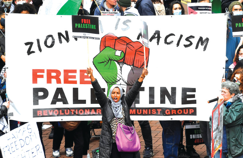 PRO-PALESTINIAN demonstrators attend a protest in London last weekend. (photo credit: TOBY MELVILLE/REUTERS)