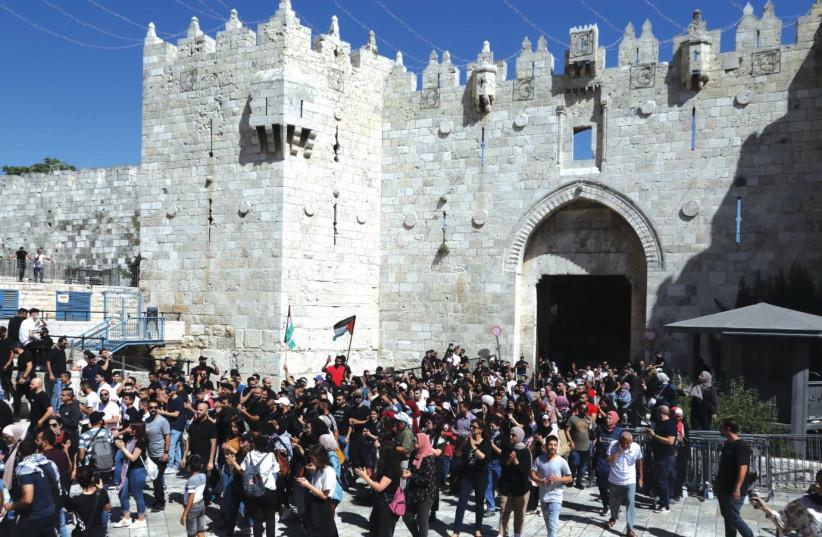 PALESTINIANS DEMONSTRATE outside Damascus Gate in Jerusalem. (photo credit: MARC ISRAEL SELLEM/THE JERUSALEM POST)