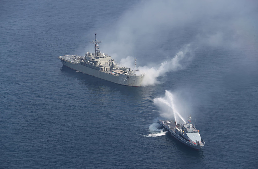 Iranian warships are seen during a joint naval exercise with Russian navy in the Indian Ocean, Iran February 16, 2021. Picture taken February 16, 2021. (photo credit: IRANIAN ARMY/WANA (WEST ASIA NEWS AGENCY) VIA REUTERS)