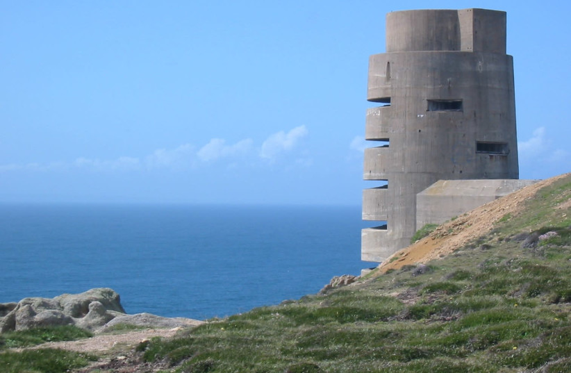 As part of the Atlantic Wall, between 1940 and 1945 the occupying German forces and the Organisation Todt constructed fortifications around the coasts of the Channel Islands such as this observation tower at Battery Moltke, Jersey (photo credit: WIKIMEDIA COMMONS/MAN VYI)