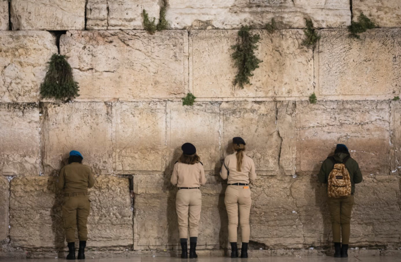 FEMALE SOLDIERS pray at the Kotel during Remembrance Day in April. (credit: OLIVIER FITOUSSI/FLASH90)