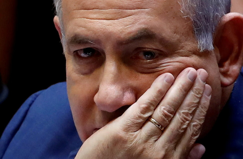 Israeli Prime Minister Benjamin Netanyahu sits at the plenum at the Knesset, Israel's parliament, in Jerusalem May 30, 2019. (photo credit: RONEN ZVULUN/REUTERS)