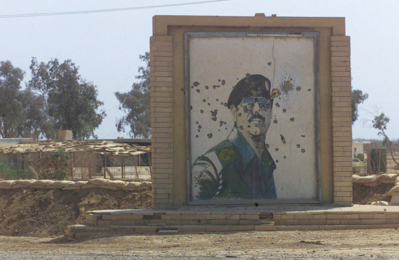 BULLET-RIDDLED mural of Saddam Hussein in southern Iraq, along the road to Baghdad (photo credit: PICRYL)