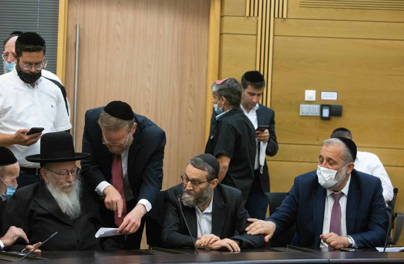 UTJ MK Yaakov Litzman together with UTJ MK Moshe Gafni and Shas head Aryeh Deri gives during a press statement at the Knesset, the Israeli parliament in Jerusalem, June 8, 2021.  (photo credit: YONATAN SINDEL/FLASH 90)
