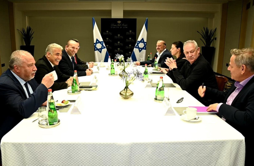 Naftali Bennett and Yair Lapid meet with the party leaders who make up their new coalition on June 6, 2021. (photo credit: ELAD GUTTMAN)
