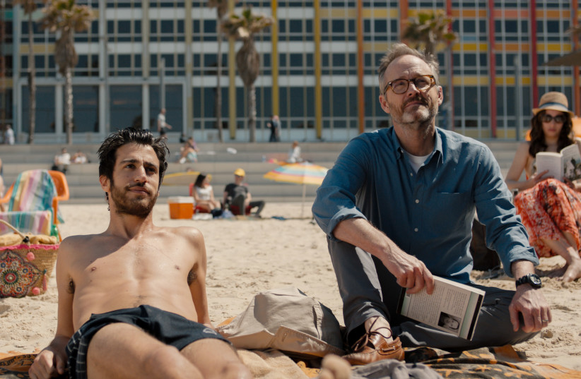 """Israeli actor Niv Nissim, left, and American John Benjamin Hickey star in the new film """"Sublet,"""" a drama from director Eytan Fox about an American travel writer who tours Tel Aviv alongside a local. (photo credit: DANIEL MILLER/GREENWICH ENTERTAINMENT)"""