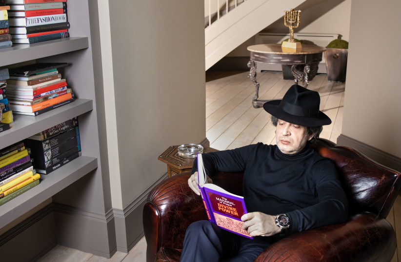 Eduard Shyfrin reading a book at his home (photo credit: Courtesy)