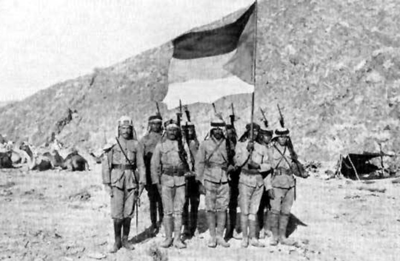 Soldiers in the Arab Army during the Arab Revolt of 1916-1918, carrying the Arab Flag of the Arab Revolt and pictured in the Hejaz. (photo credit: Wikimedia Commons)
