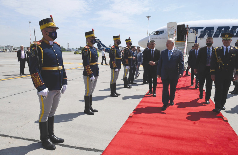 PRESIDENT REUVEN RIVLIN is received by a Romanian honor guard. (photo credit: MARK NEYMAN/GPO)