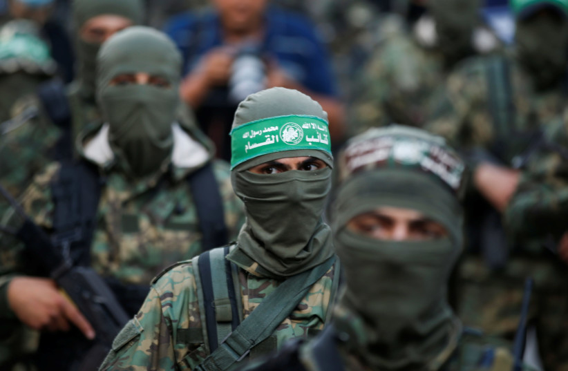 Palestinian Hamas militants take part in an anti-Israel rally in Gaza City May 22, 2021 (photo credit: REUTERS/MOHAMMED SALEM)