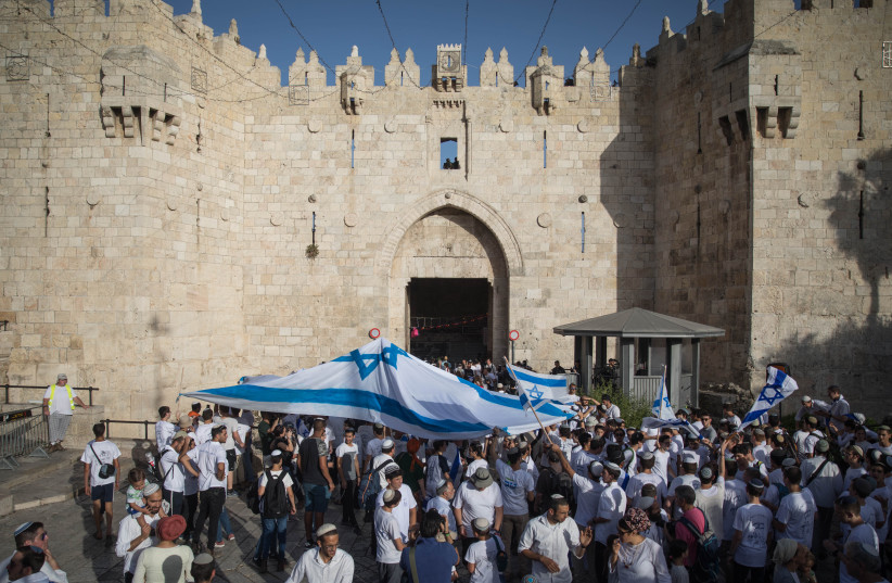 Young Jewish men celebrate Jerusalem day at the Muslim Quarter in the Old City of Jerusalem, June 2, 2019. (photo credit: HADAS PARUSH/FLASH90)