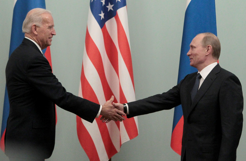 Russian Prime Minister Vladimir Putin (R) shakes hands with then US Vice President Joe Biden during their meeting in Moscow March 10, 2011. (photo credit: REUTERS/ALEXANDER NATRUSKIN/FILE PHOTO)