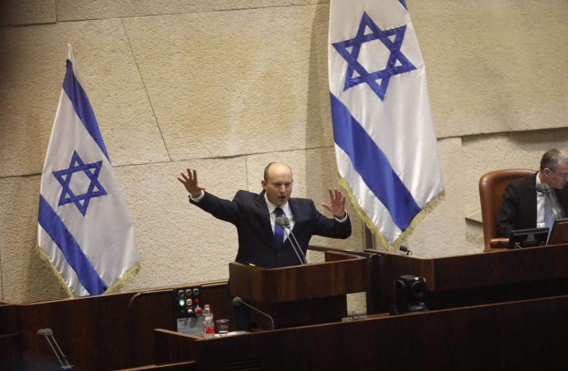 Incoming Prime Minister Naftali Bennett addresses the Knesset plenum ahead of swearing in of new government. (photo credit: MARC ISRAEL SELLEM)