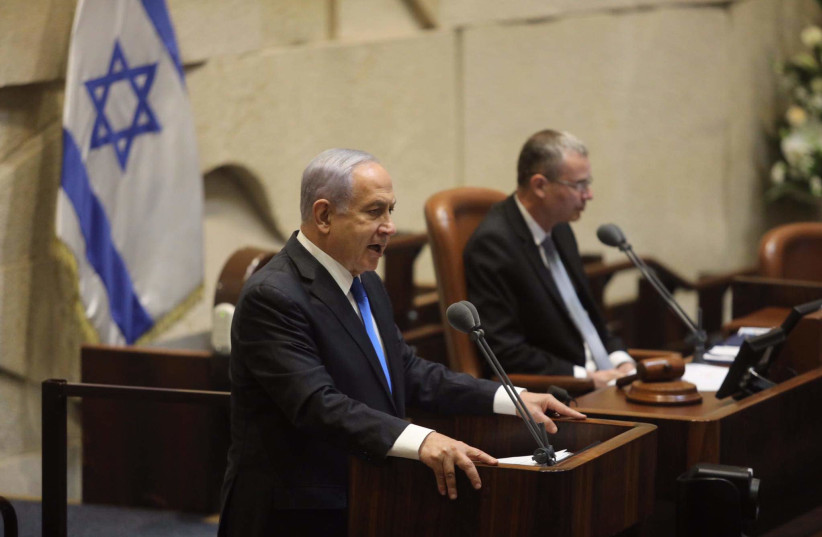 Prime Minister Benjamin Netanyahu addresses Knesset plenum ahead of the new government's swearing in.  (photo credit: MARC ISRAEL SELLEM)