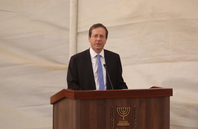 Incoming President Isaac Herzog speaks at the memorial for Yoni Netanyahu  (photo credit: MARC ISRAEL SELLEM)